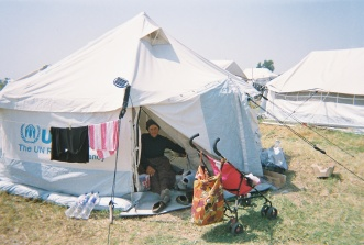 "Khadija Toghaji / IFRC ""This woman is about 70 years old, and she lives here in the camp by herself."""